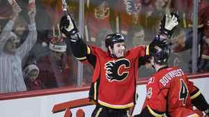 Calgary Flames' Curtis Glencross celebrates a goal with Jay Bouwmeester against the Detroit Red Wings during the 1st period of their NHL hockey game in Calgary, Alberta, December 22, 2011.