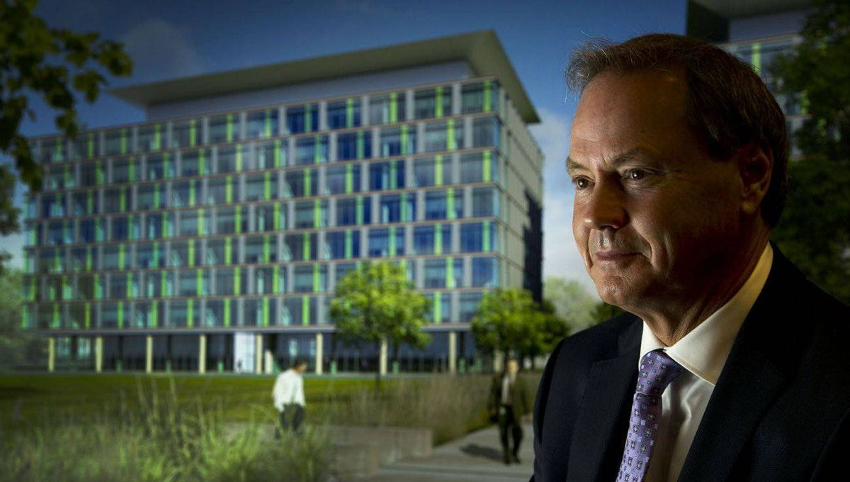 Paul Langer of DTZ Barnicke, with a rendering of the Milestone Corporate Centre in Vaughan, Ont., behind him.