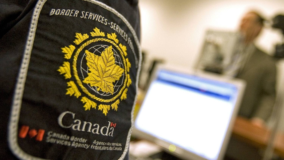 A Canadian Border Services Agency guard screens passengers at Pearson airport in Toronto in September of 2007.