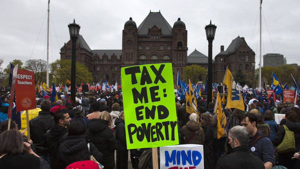 People attend the 'We Are Ontario' rally organised by the Ontario Federation of Labour at Queen's Park in Toronto, April 21, 2012