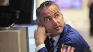 A trader works on the floor of the New York Stock Exchange on October 7, 2011 in New York City.