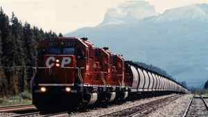 CP grain train near Lake Louise, Alberta, c. 1995. CP Rail System transports about 50% of all the grain that moves by rail in Canada. Its trains move grain from the Prairies to the ports of Vancouver, Thunder Bay, Montreal and Trois Rivieres for export overseas, and to the United States. Canada exports about 30 million short tons of grain a year.
