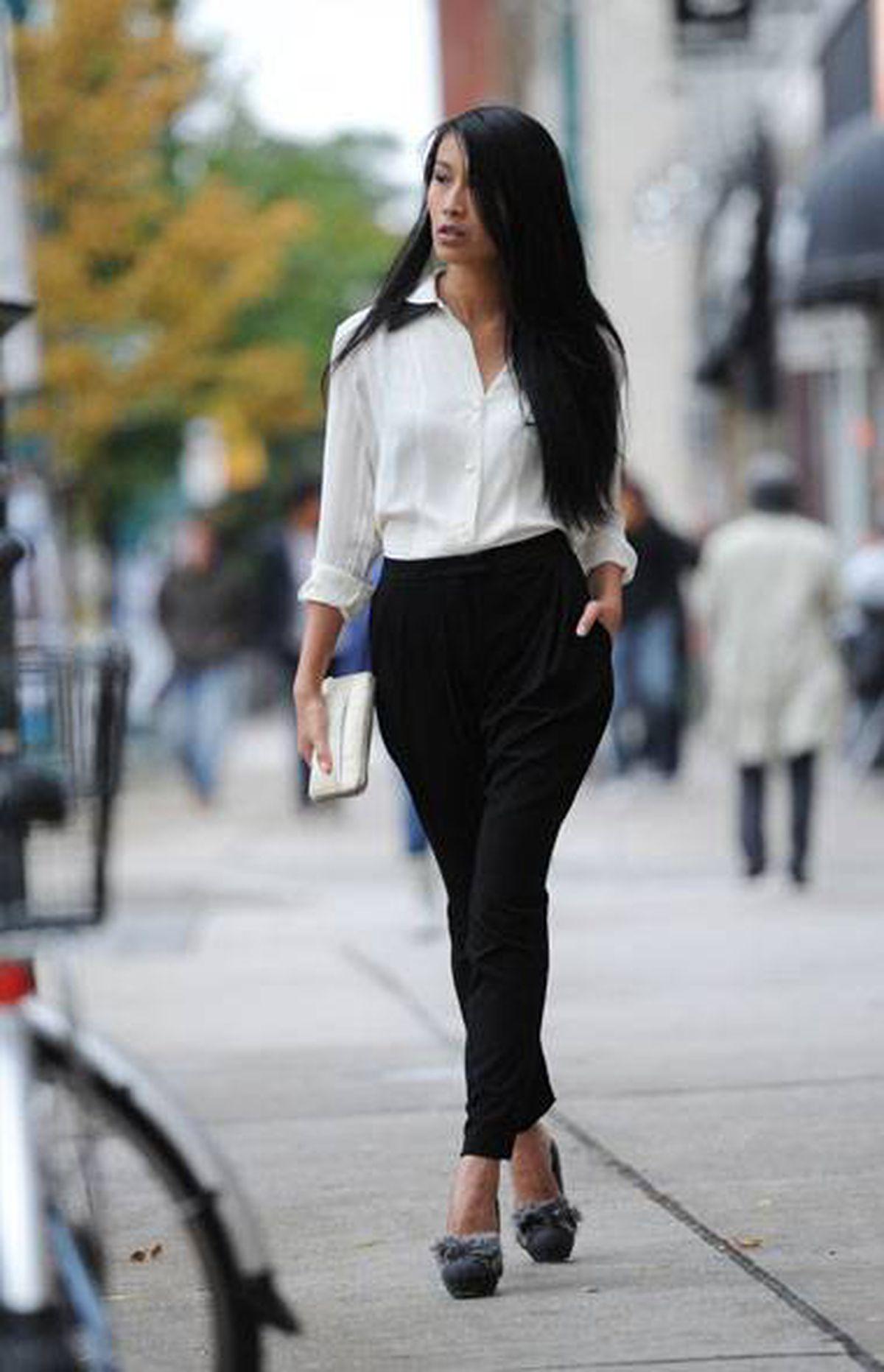 Chloe blouse, $595, Lida Baday pants, $425 at Holt Renfrew (www.holtrenfrew.com). Nina Ricci pumps, $995 at the Room (www.hbc.com).