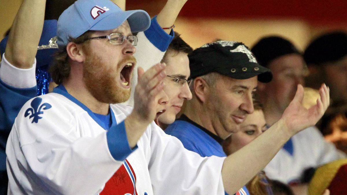 A fan of the former Canadian hockey team Quebec Nordiques cheers during the third period of an NHL hockey game between the Boston Bruins and the New Jersey Devils, Sunday, April 10, 2011, in Newark, N.J. The Devils won 3-2. (AP Photo/Julio Cortez)