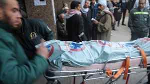 The body of a victim of clashes at a soccer stadium is seen outside a morgue in Cairo, Egypt, Thursday, Feb. 2, 2012.