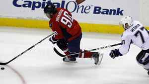 Washington Capitals center Marcus Johansson skates with the puck as he is defended by New York Rangers defenseman Victor Hedman from Sweden, during the first period in Game 2 of a conference semifinal NHL Stanley Cup hockey playoff series Sunday, May 1, 2011 in Washington. The Lighting won 3-2 in overtime. (AP Photo/Alex Brandon)