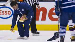 A member of the ice crew picks up waffles tossed on the ice on Dec. 20 during a game against the Atlanta Thrashers.