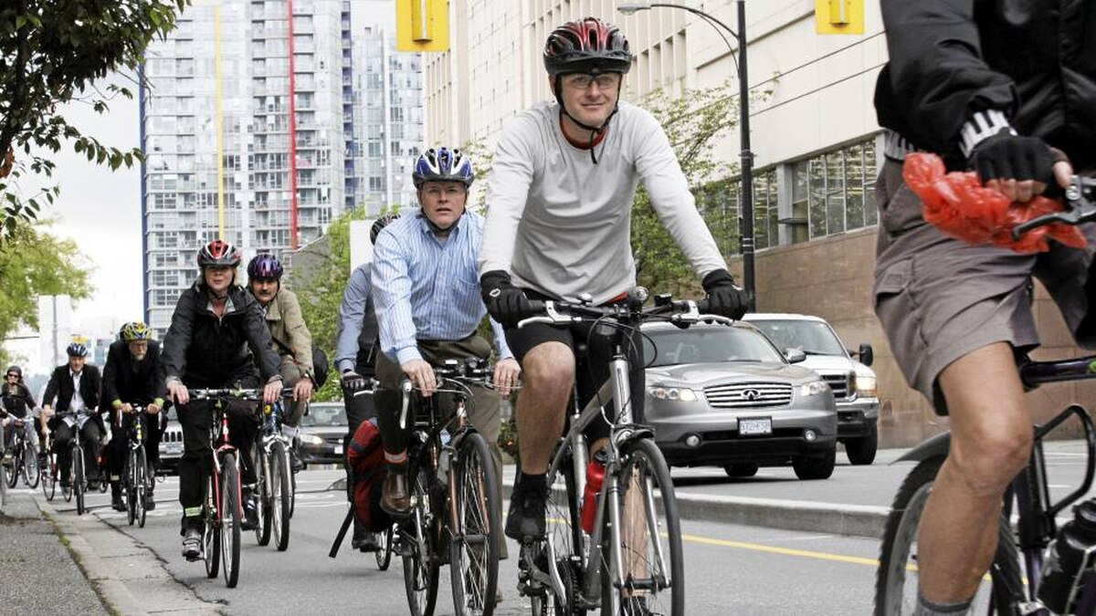 Cyclists use the Dunsmuir Street bike lane in Vancouver on June 15, 2010. The separated lane provides an easier, more comfortable cycling connection to and from the downtown area.