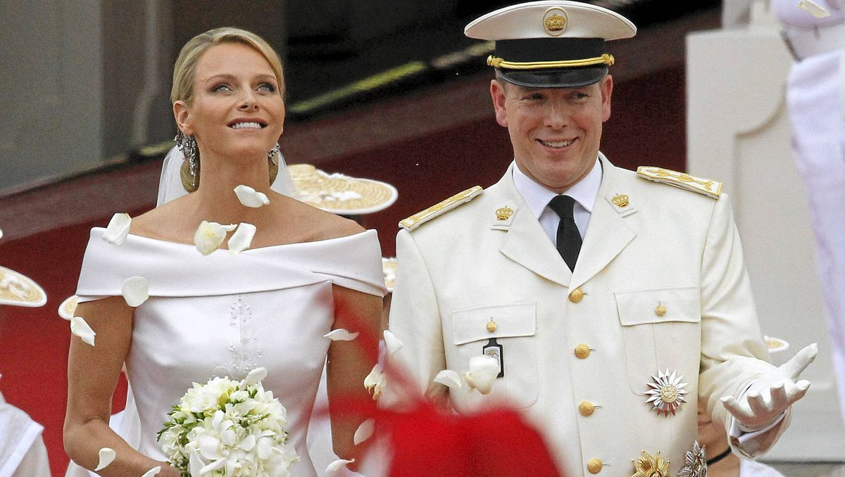 Prince Albert II of Monaco and Princess Charlene of Monaco leave the Prince's Palace after their religious wedding on July 2, 2011 in Monaco.