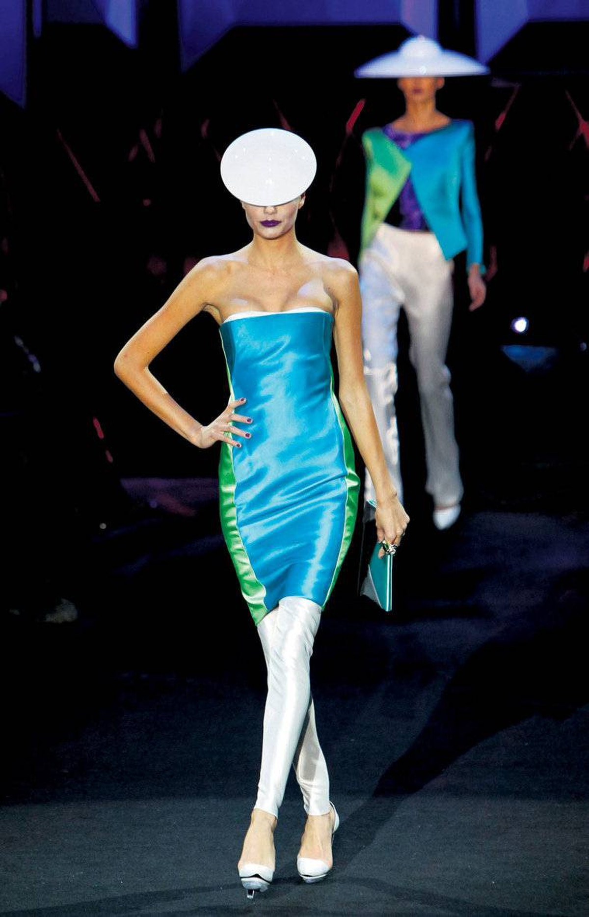 Armani Priv�?s glam, space-age-inspired collection featured sleek separates in silky metallic fabrics topped with spherical headgear by famed British milliner Philip Treacy.