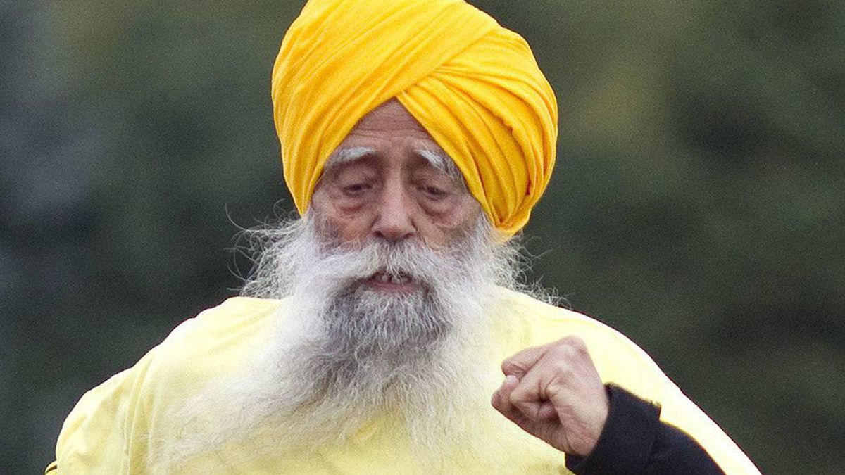 Centenarian Fauja Singh crosses the finish line as he sets a World Record at the 100 meters race for centenarian at 23.4 seconds in Toronto Thursday 13 October 11, 2011, beating the previous record by 6 seconds. One-hundred-year-old Singh, originally from Beas Pind, in Jalendhar, India but now lives in London England, set world records at several distances as he warms up for Toronto's Waterfront Marathon which takes place this Sunday. THE CANADIAN PRESS/Chris Young.