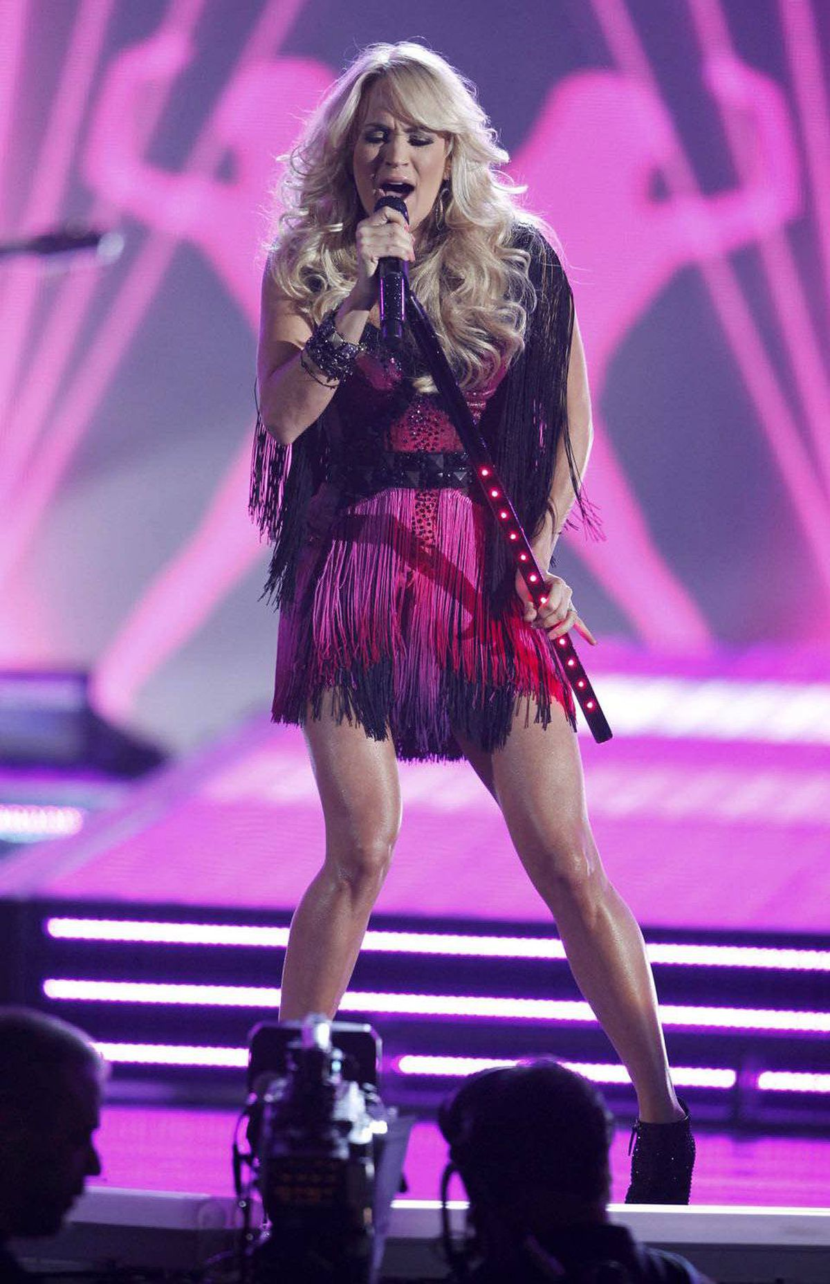 Singer Carrie Underwood struggles to co-ordinate her accessories with her fuchsia silhouettes at the Country Music Awards in Las Vegas.