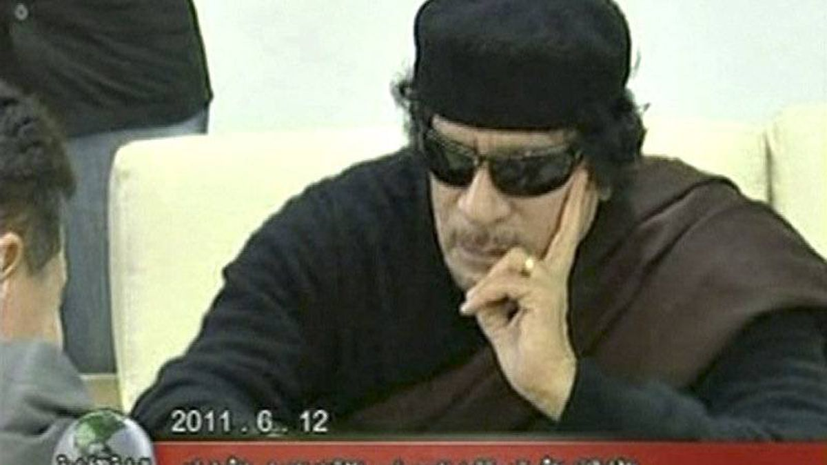 Libyan leader Moammar Gadhafi plays chess with Kirsan Ilyumzhinov, the president of the international chess federation, in Tripoli on June 12, 2011 in this still image taken from video broadcast on Libyan state television.