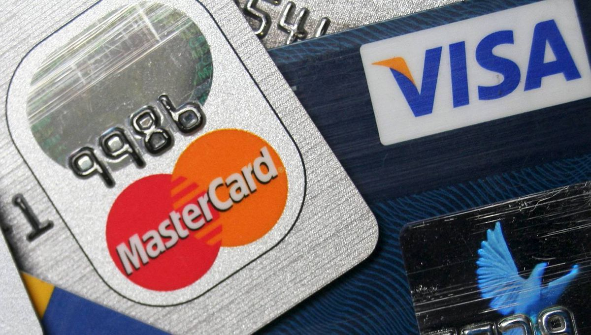 This photo shows a stack of MasterCard and VISA credit cards