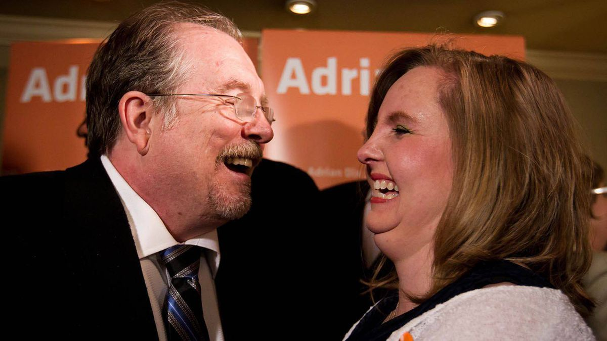 Conservative candidate John Martin, left, congratulates NDP MLA-elect Gwen O'Mahony as she celebrates her by-election win in the riding of Chilliwack-Hope, in Chilliwack, B.C., on April 19, 2012.