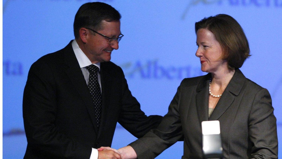 Alberta Premier Ed Stelmach shakes hands with Alison Redford as she celebrates becoming leader of the party and the new premier following the second ballot in the party's leadership race in Edmonton, Alta., Saturday, Oct. 1, 2011.