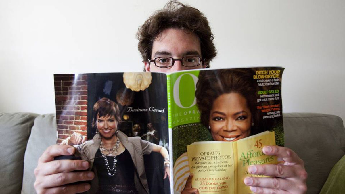 Hal Niedzviecky, author of The Peep Diaries, holds the recent issue of O, The Oprah Magazine, which lists his book as one of 25 Books You Can't Put Down. (Della Rollins for the Globe and Mail)