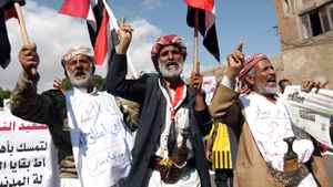 Yemeni protesters shout slogans during an anti-regime demonstration in Sanaa on November 27, 2011 as President Ali Abdullah Saleh returned to Yemen from Riyadh, where he signed a deal to step down under which a new presidential poll is take place in February, state news agency Saba reported.