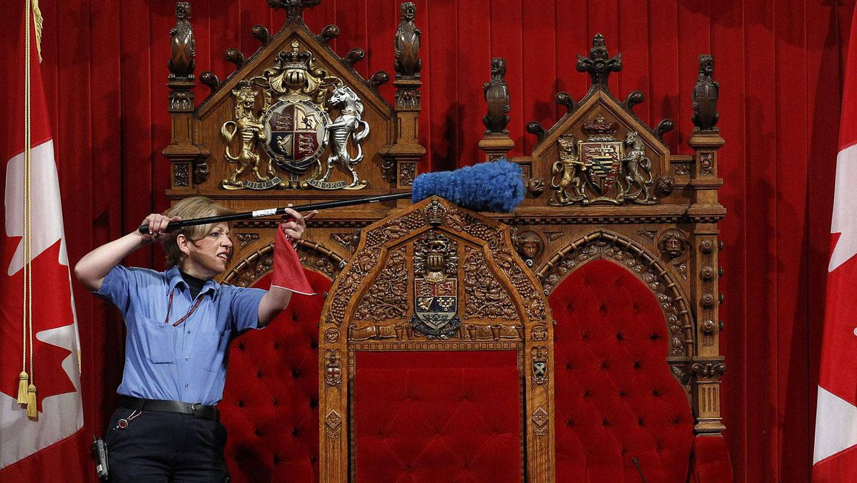 A worker cleans the Senate chamber on Parliament Hill in Ottawa June 1, 2011.