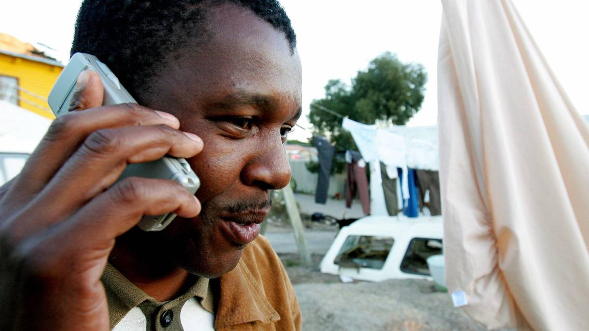 A township resident chats on his mobile phone in Hout Bay near Cape Town in this 2006 file photo.