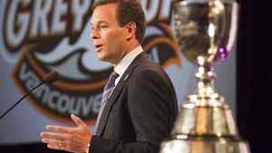 CFL commissioner Mark Cohon speaks next to the Grey Cup at the annual state of the league media conference in Vancouver, British Columbia, November 25, 2011. The B.C Lions take on the Winnipeg Blue Bombers in the 99th Grey Cup in Vancouver on Sunday. REUTERS/Ben Nelms