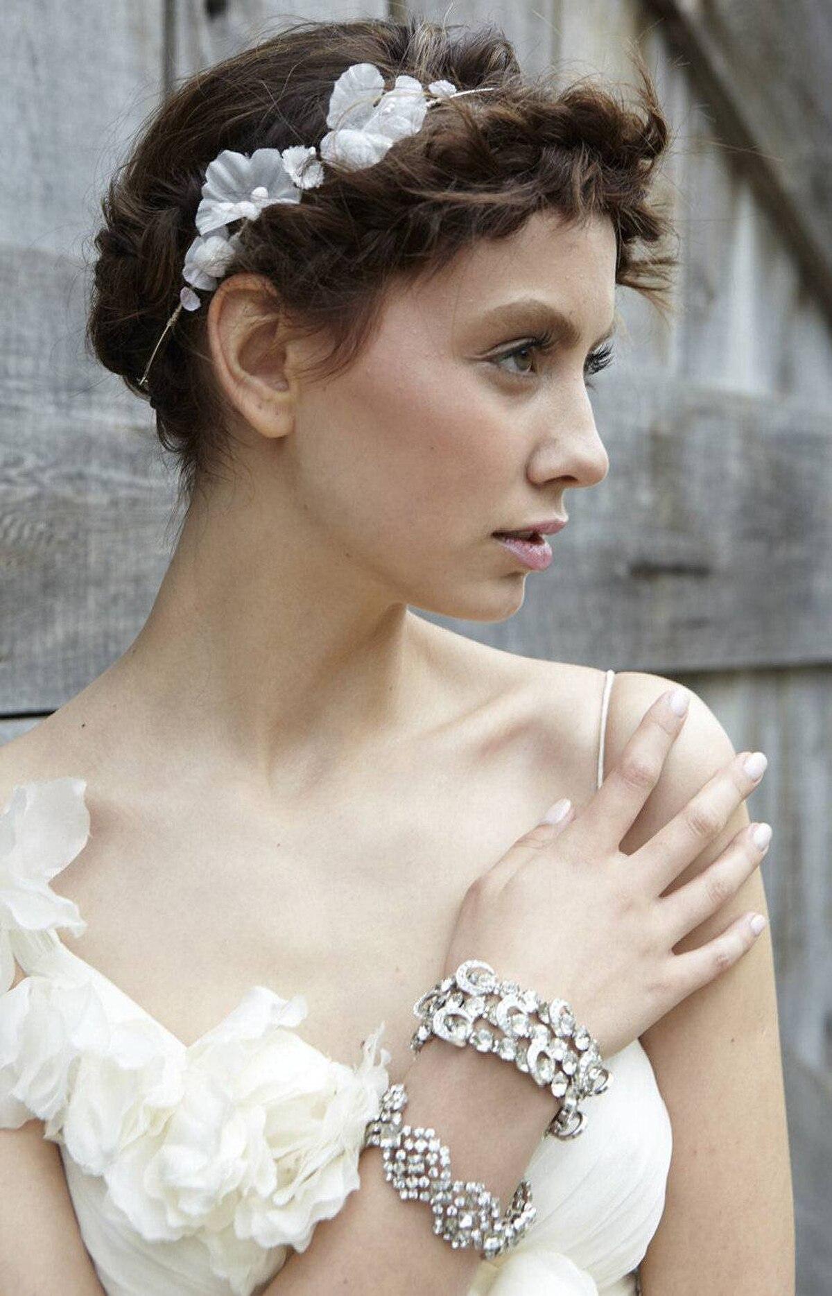 Carole Tanenbaum bracelets, $550 and $350, floral headpiece, $350 at White Toronto (www.whitetoronto.com).