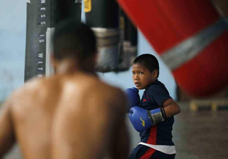 "Ezequiel Quiroz, 13, known as ""Alcon"", practises with a punch bag at the Rockero Alcazar gym in the low-income neighbourhood of Curundu in Panama City."