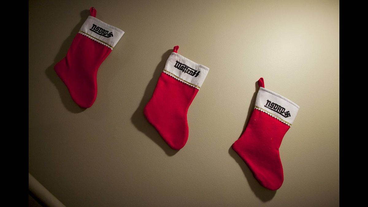 Christmas stockings, specially ordered from a Nazi website, line the stairs of Kyle McKee's Calgary home.