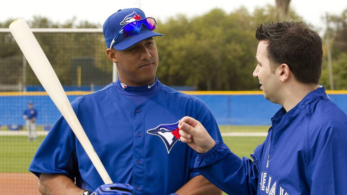 Toronto Blue Jays Yunel Escobar chats with GM Alex Anthopoulos at Jays Spring Training in Dunedin, Fla. on Saturday February 25, 2012.