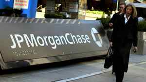 Pedestrians walk past the JP Morgan Chase headquarters in New York in this March 17, 2008 file photo.