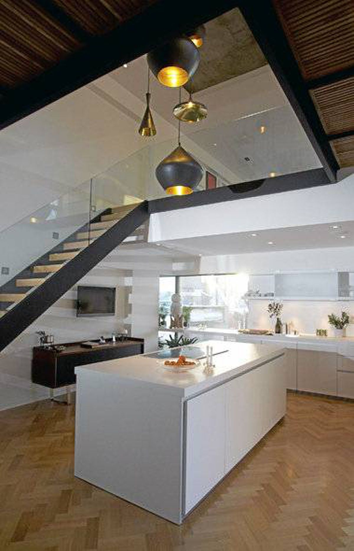 Interior photo showing kitchen in Byron Peart's condo at Habitat 67 in Montreal.