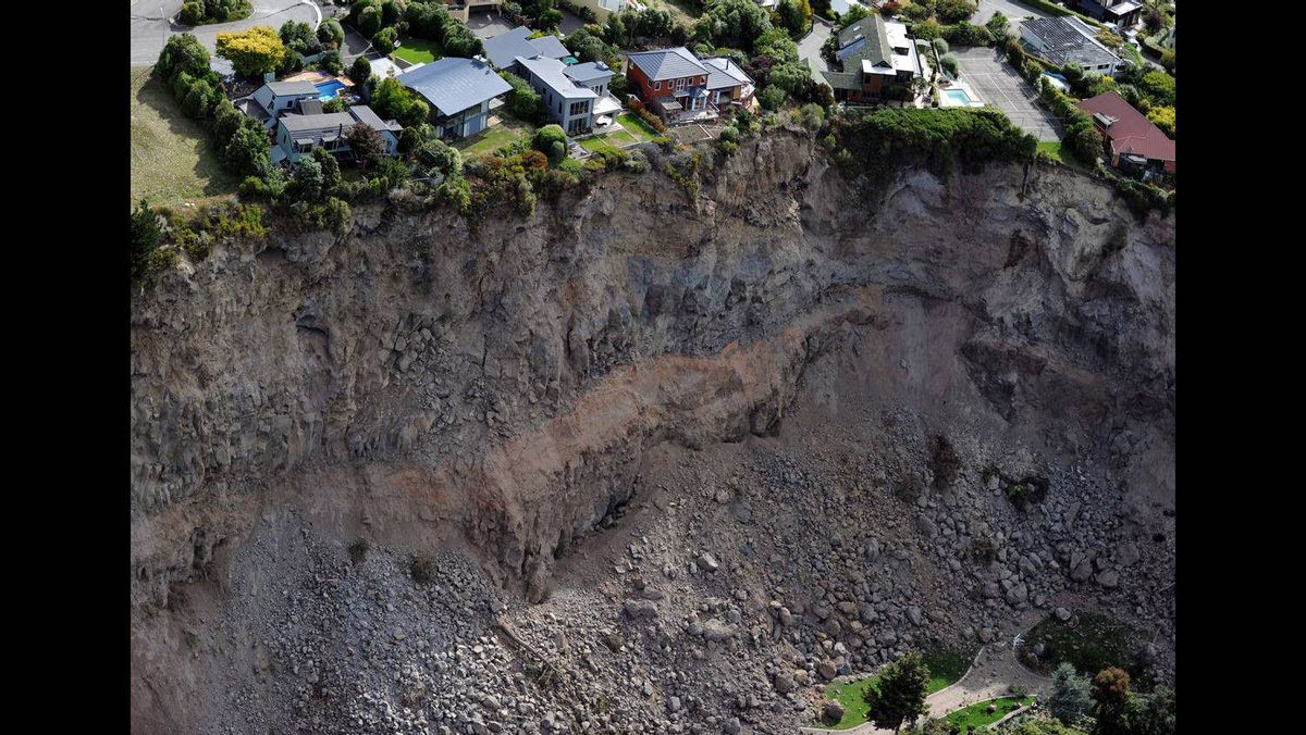 Luxury houses teeter on the edge after landslides in Redcliffs near Christchurch on February 27, 2011, after a 6.3 earthquake devastated New Zealand's second city and surrounding towns on February 22.