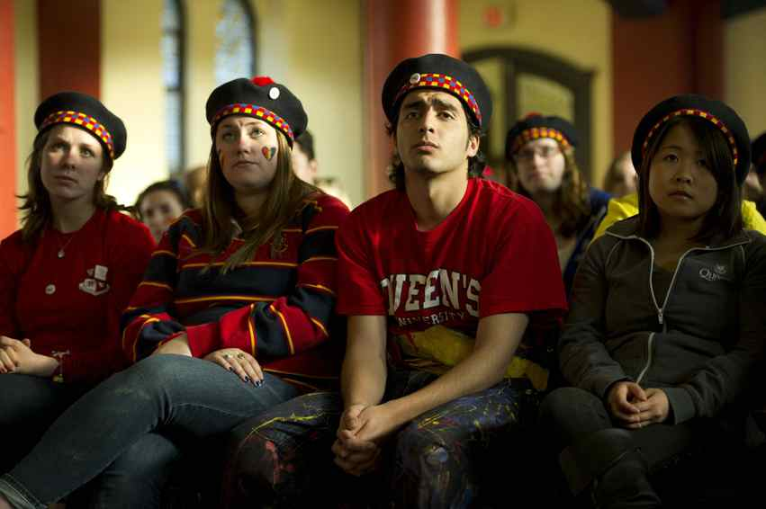 Queen's University students take part in an event called Queen's Loves U following the deaths of six students in recent months.