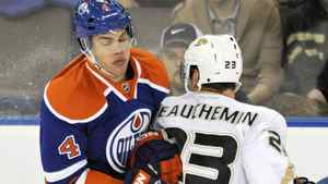 Edmonton Oilers' Taylor Hall (L) collides with Anaheim Ducks' Francois Beauchemin during the first period of their NHL hockey game in Edmonton January 13, 2012. REUTERS/Dan Riedlhuber