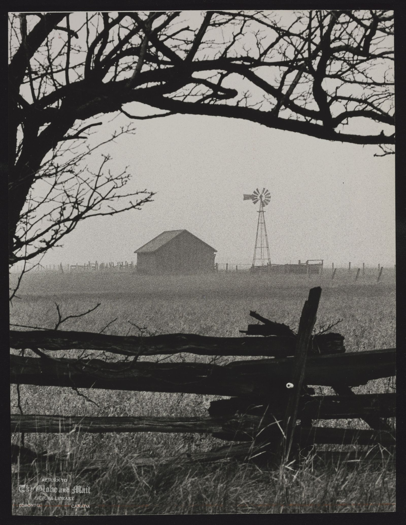 ONTARIO Misc. Farm outbuilding and a windmill are shrouded in mist near Britannia Sideroad in Milton, Ont.