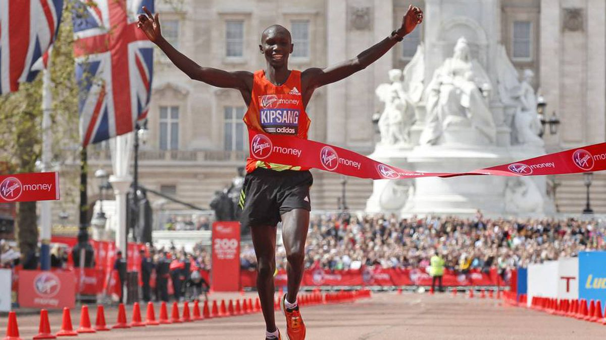 Kenya's Wilson Kipsang celebrates his win as he crosses the finish line during the London Marathon on Sunday.
