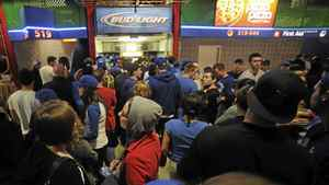 Fans line up for beer at the Toronto Blue Jays home opener against the Boston red Sox April 9, 2012.