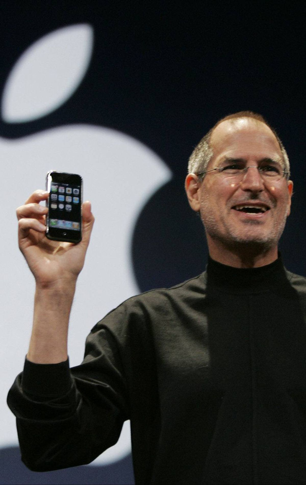 Apple CEO Steve Jobs holds up the new iPhone during his keynote address at MacWorld Conference & Expo in San Francisco, Tuesday, Jan. 9, 2007. (AP Photo/Paul Sakuma)