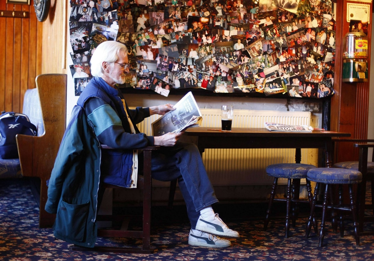 A customer reads a newspaper at the Greyhound pub in east London.