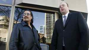 Rob Sinclair (left) , cousin of Brian Sinclair, a homeless man who died after a 34-hour wait in an emergency ward, and Vilko Zbogar, Toronto-based lawyer for the Sinclair family, are shown outside the Winnipeg Law Courts, Tuesday, Nov.17, 2009.