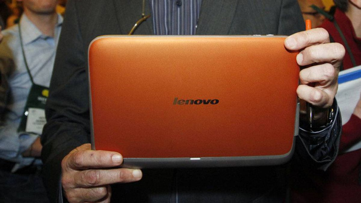 "A man displays an unannounced Lenovo tablet computer running the full Windows 7 operating system at a preview of the Consumer Electronics Show (CES) in Las Vegas January 4, 2011. According to a spokesman at the show, the computer, scheduled to be available in May, has a tentative name of the IdeaPad Slate, uses the Intel ""Oak Trail"" 1.6gHz processor chip and has a 32gb SSD drive and a microSD slot."