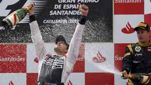 Williams Formula One driver Pastor Maldonado (L) of Venezuela is sprayed with champagne during the podium ceremony at the Circuit de Catalunya in Montmelo, near Barcelona, May 13, 2012.