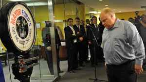 Toronto Mayor Rob Ford heads for the scale during his a weigh-in at City Hall on April 6, 2012.