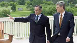 Prime Minister Stephen Harper walks with local MP Tony Clement before making an announcement in Huntsville, Ont., June 19, 2008. Huntsville hosted the 2010 G8 meetings at the Deerhurst resort.