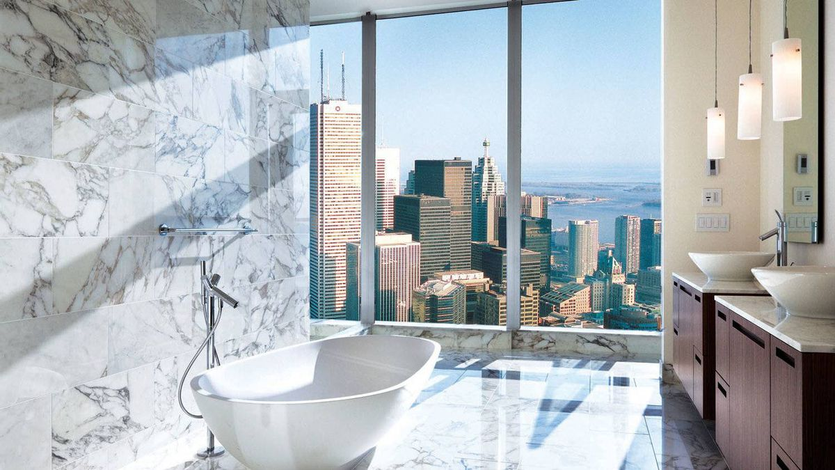A rendering of the interior of a suite in the Shangri-La tower in Toronto, featuring panoramic city views.