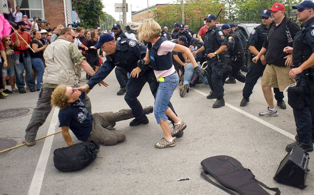 Police clash with G20 demonstrators at the temporary dentention center in Toronto.