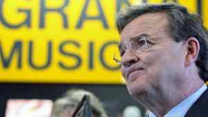 Finance Minister Jim Flaherty speaks to reporters at a music store in Ottawa on March 23, 2011.