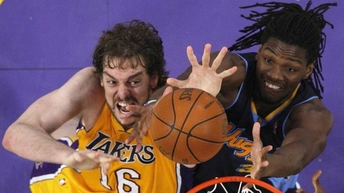 Los Angeles Lakers' Pau Gasol of Spain (L) and Denver Nuggets' Kenneth Faried fight for a rebound during Game 7 of their NBA Western Conference basketball playoff series in Los Angeles
