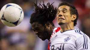 FC Dallas' Ugo Ihemelu, left, and Vancouver Whitecaps' Camilo Sanvezzo, of Brazil, jump for the ball during the second half of an MLS soccer game in Vancouver, B.C., on Saturday April 21, 2012. THE CANADIAN PRESS/Darryl Dyck