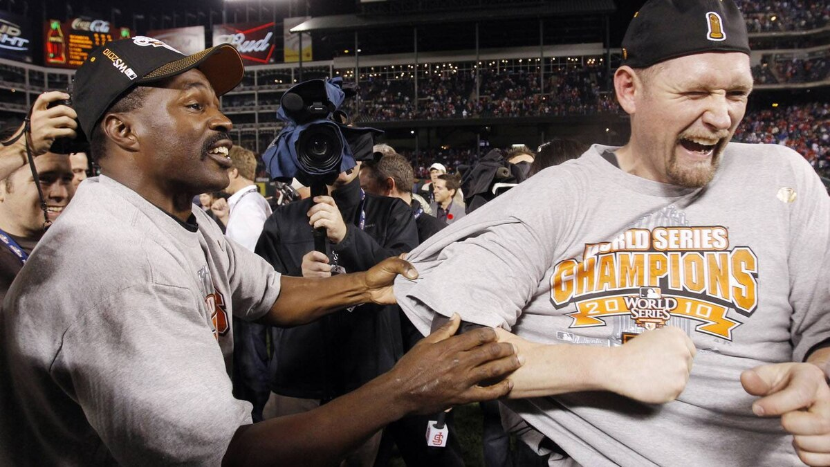 San Francisco Giants Aubrey Huff and coach Shawon Dunston (L) celebrate defeating the Texas Rangers in Game 5 to win Major League Baseball's World Series in Arlington, Texas, November 1, 2010. REUTERS/Mike Segar
